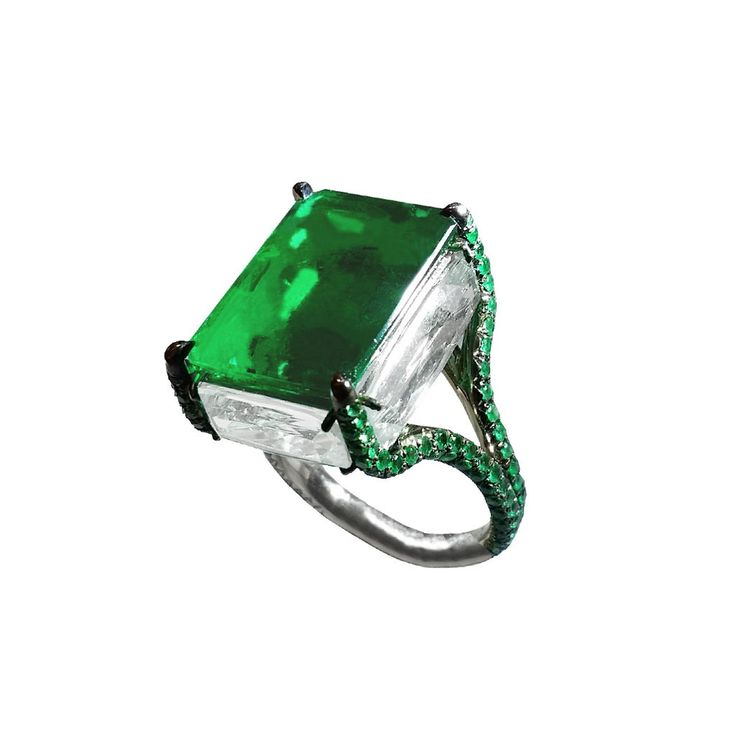 An 11 carat Colombian emerald sits atop four green beryls in this Boghossian high jewellery ring. http://www.thejewelleryeditor.com/jewellery/article/boghossians-daring-creations-are-perfect-reason-visit-masterpiece/ #jewelry
