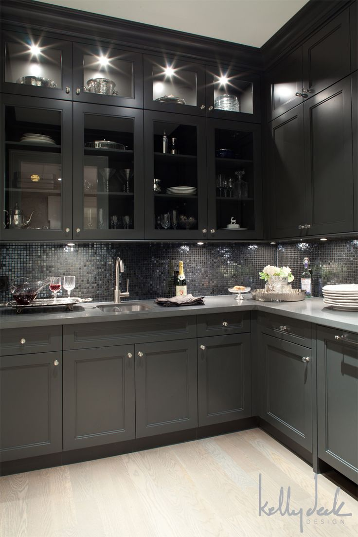 dark cabinetry, light floors