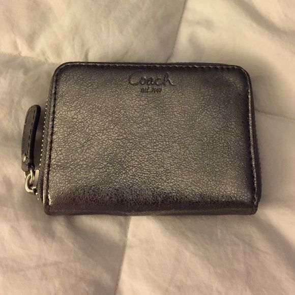 Coach wallet Small silver Coach wallet. Only used twice.  4 in x 3in.  Four card slots and change pocket which is zippered on the interior. Silver metallic. ID slot on the back. Coach Bags Wallets
