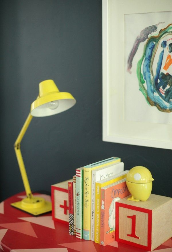 Side table makeover; framed childrens artwork, colorful lamps, ABC blocks as bookends #emilyhenderson