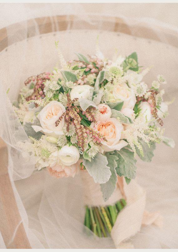 White O'Hara Garden Roses, Wild Eve Garden Roses, Pink Pierus Japonica, White Ranunculus, White Scabiosa, White Astrantia, Lamb's Ear, Dusty Miller, White Astilbe and Tuberose.