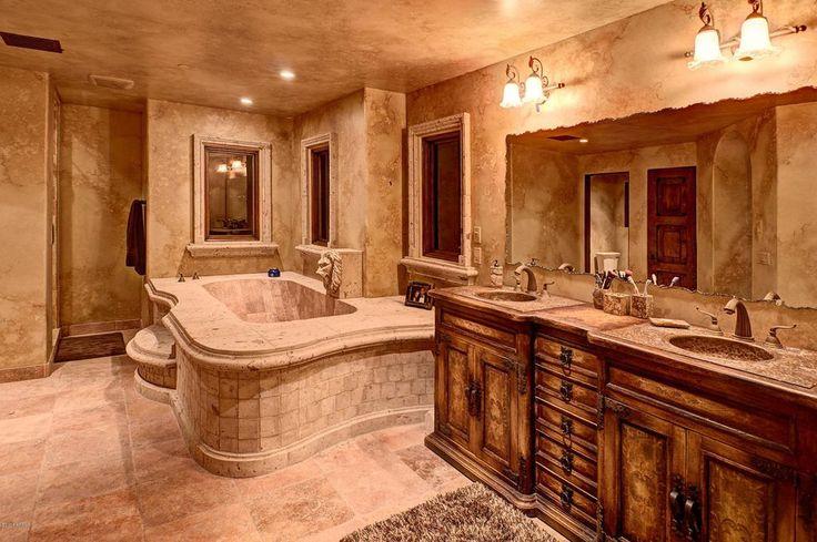 Mediterranean Master Bathroom with Flat panel cabinets, Master bathroom, Drop-In Bathtub, Limestone counters, Undermount Sink