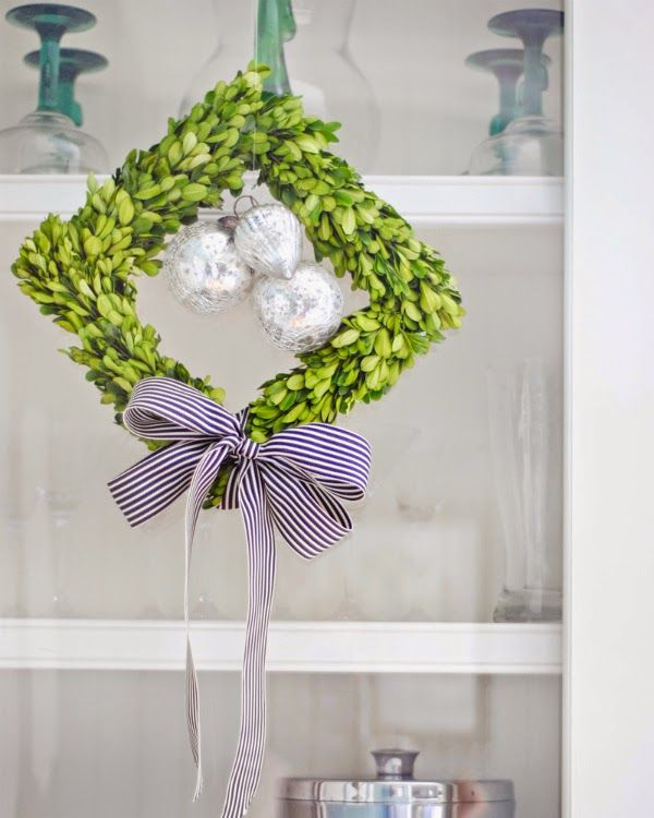 garland with clusters if christmas ornaments | hung square preserved boxwood wreaths on the custom glass doors of ...