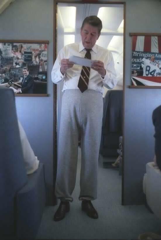 President Reagan aboard Air Force One wearing sweatpants. 1986