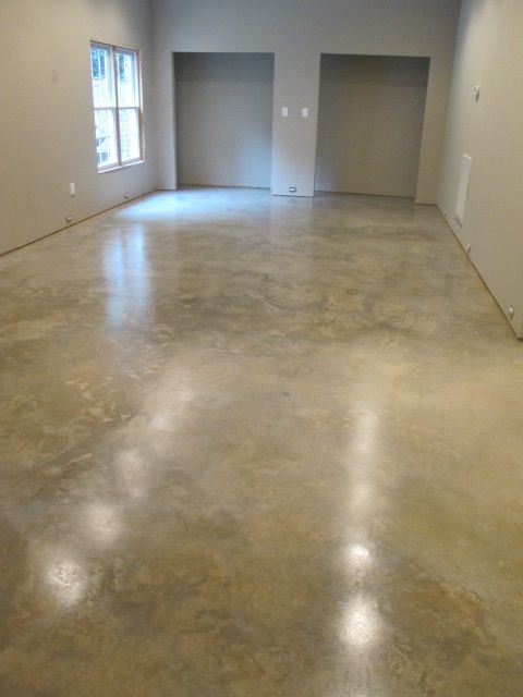 Natural concrete floor sanded and sealed with Euclid Chemical Everclear VOX water-based acrylic concrete sealer