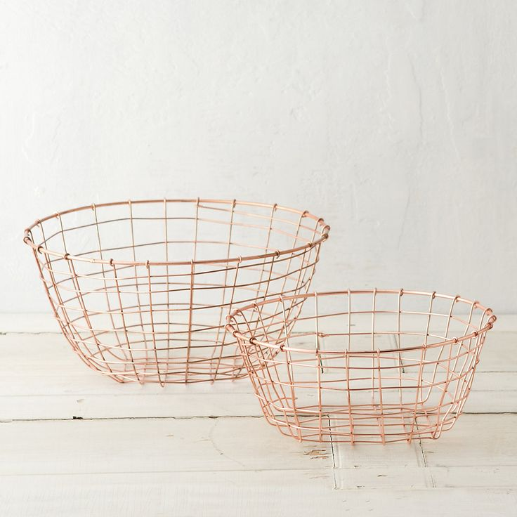 "Copper-plated wire adds sophisticated shine to these woven baskets, ideal for organizing the office or pantry.- Copper-plated metal wire- Wipe clean with damp cloth- Indoor use only- ImportedSmall: 4.25""H, 10.5"" diameterLarge: 6""H, 12.75"" diameter"