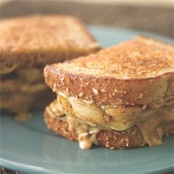 Grilled Banana Sandwich; Banana, peanut butter, low fat cream cheese, and cinnamon. Breakfast! 320 Calories. :)