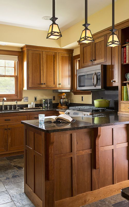 Craftsman details abound in this updated kitchen. Custom cherry cabinets  were left unstained to highlight their natural grain and color.