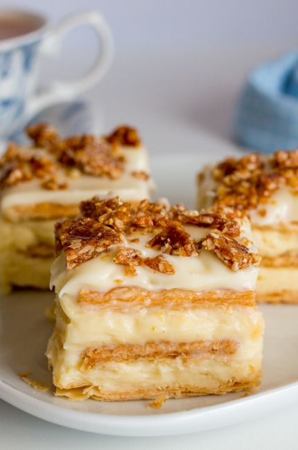Vanilla Slice with Hazelnut Crunch - creamy layers of custard sandwiched between crisp pastry and topped with frosting and caramelized hazelnuts