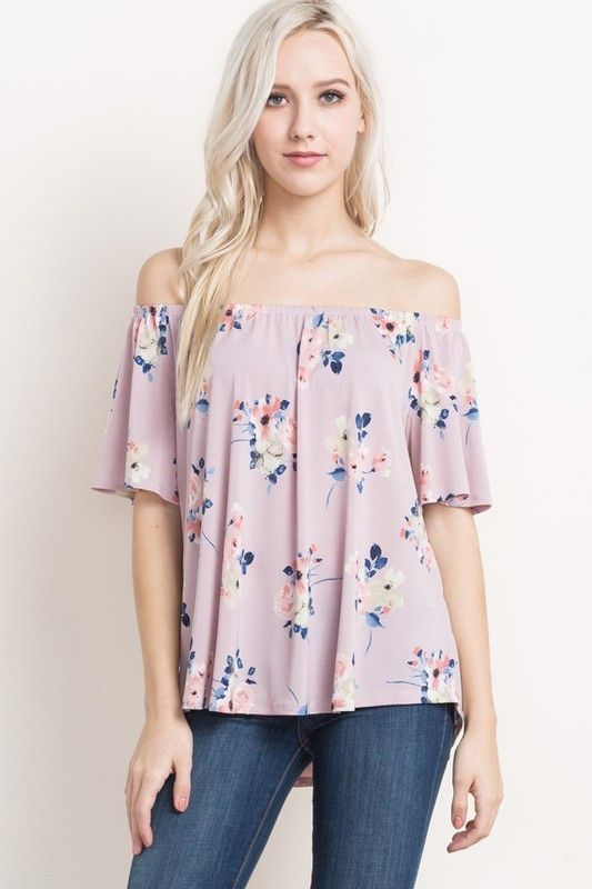 Adorable and dainty lavender floral print top that falls off the shoulder with an elastic bodice band. The flutter short sleeves and shift style body falls effortlessly. Tuck into jeans or pair with y