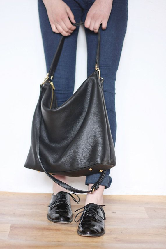 This black leather hobo bag is made from high quality pebbled Italian leather and is lined with soft natural linen. The bag is soft and slouchy. It