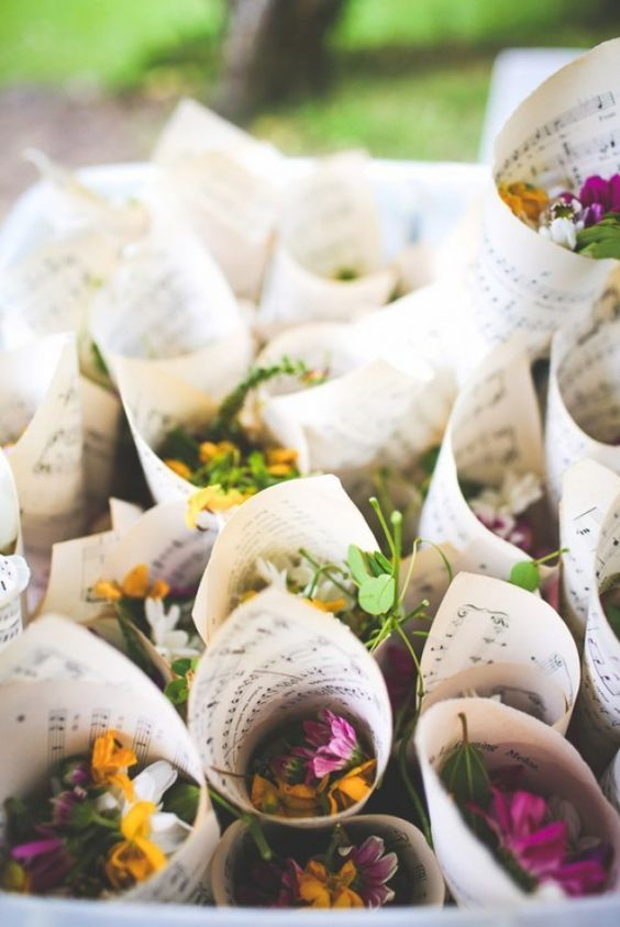Wild Flowers: What's a bohemian wedding without some wild flowers? This couple wrapped their buds in paper cones — made of sheet music.: