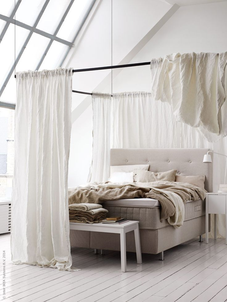 Bed canopies help create the feeling of having a sleep sanctuary to retreat to after a long, busy day. You can create your own bed canopy by draping curtains or fabric on rods.