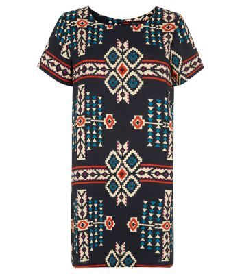 Team this Aztec print with black strap heels for an evening look with effortless style.- All over Aztec print- Simple short sleeves- Round neck- Casual fit- Soft breathable fabric
