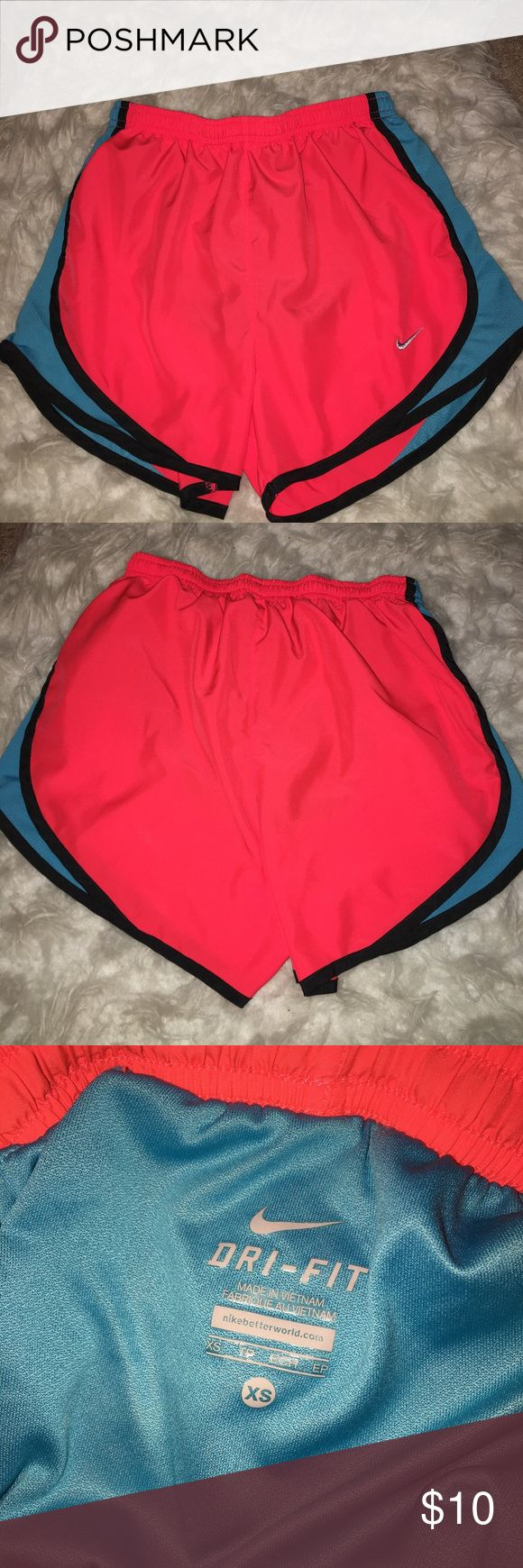 Nike running shorts Neon pink and blue NIKE running shorts. Super cute & comfy for working out. Selling bc I have too many. Runs kinda big so could fit a small Nike Shorts