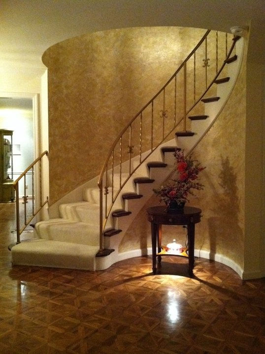 This Venetian Plaster Finish Makes A Grand Statement Inside This Curved Staircase Venetian