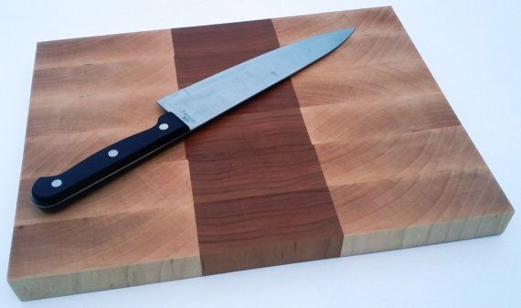 Fantastic End Grain Cutting Board made from Maple and Cherry, perfect for your chopping needs and protecting your knives from damage. This Board was handmade by a craftsman in the USA. Dimensions: 13.25 x 10 x 1 Materials: Cherry, Maple Use: For cutting vegetables, fruit and cheese. Not suitable for cutting meat due to bacteria NOT DISHWASHER SAFE All Arkeo Woodcraft products are handmade in a home studio by craftsman Glen Huff. Glen is a physical therapist assistant by day and craftsman by…