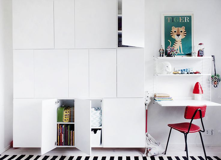 storage made with several IKEA kitchen cabinets. We did something like this and love it