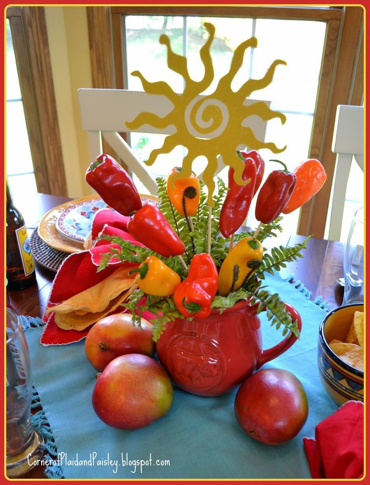 Corner of Plaid and Paisley: Cinco de Mayo Table- Hot Centerpiece! Adorable with real peppers and styrofoam cup instead of floral foam. Great idea.