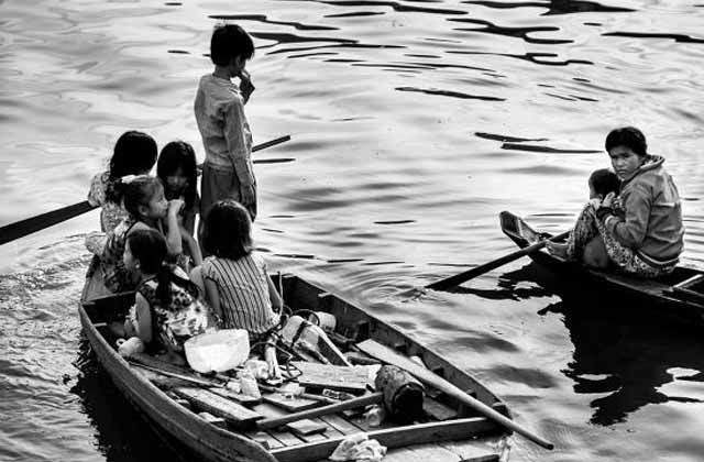 Locals on the river in Siem Reap.