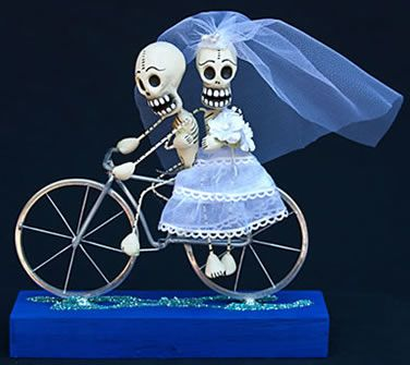dios de los muertos significance inr elation to wedding themes- sounds perfect for our costume concept! box of wine