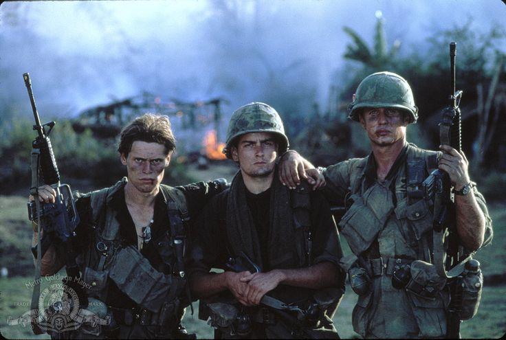 Charlie Sheen, Tom Berenger, and Willem Dafoe in Platoon (1986)
