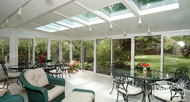 White Aluminum Frame Four Season Room with Glass Roof Panels. Interior home photos. Learn more!