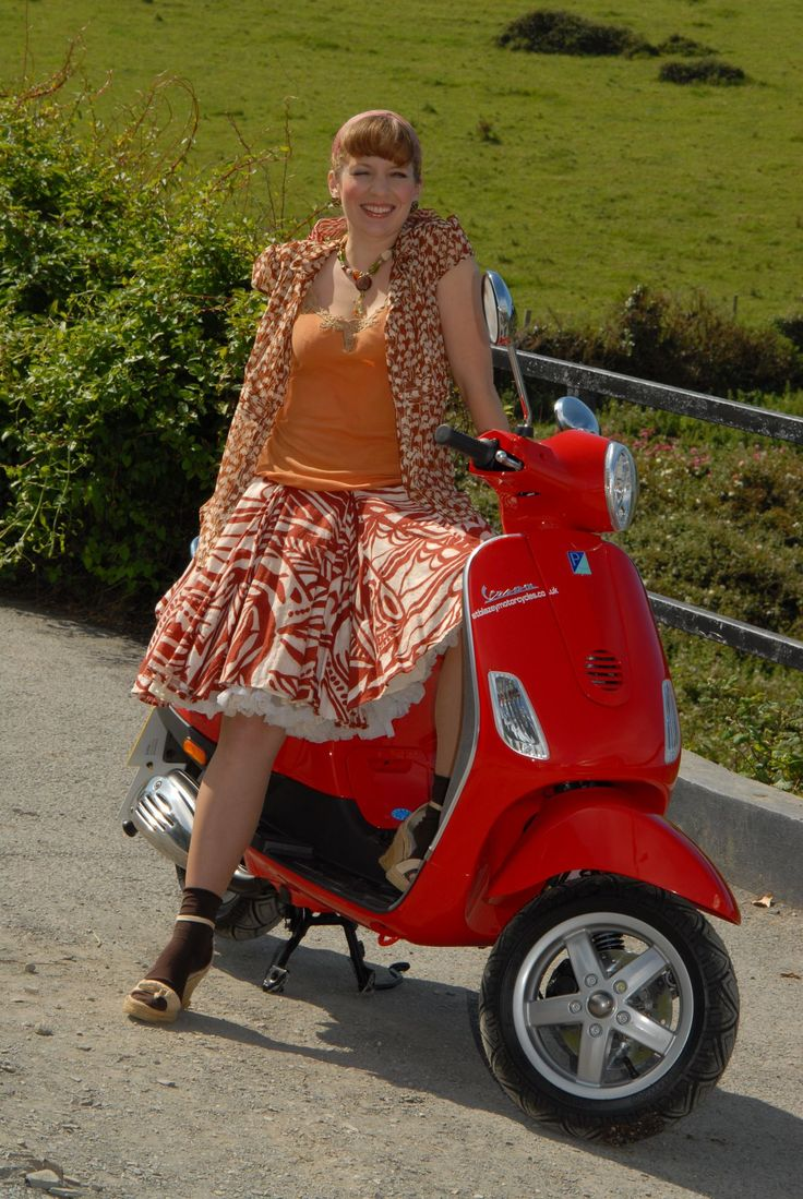 "Pauline from TV show, ""Doc Martin"", on her scooter."
