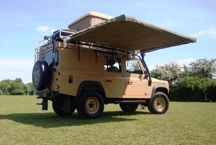 an overland vehicle prepared with an awning perfect for the camp