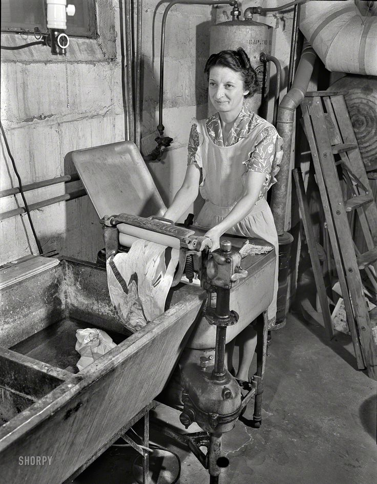 """March 1943. """"Rochester, N.Y. Mrs. Babcock doing the family laundry with an electric washing machine and a wringer."""" All the modern conveniences -- the wringer is motorized. Photo by Ralph Amdursky for the OWI."""