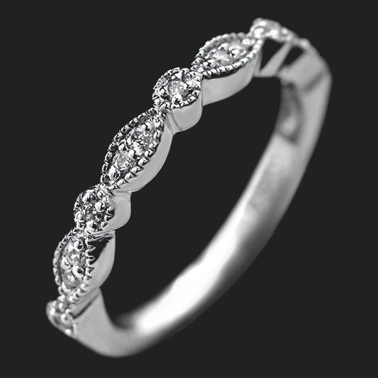 "The Amore, meaning ""love"" in Italian, is a beautiful Vintage Diamond Wedding Band. Set with 0.13ctw natural recycled diamonds in a delicate milgrained band, this wedding band perfectly matches the Amore Vintage Engagement Ring.