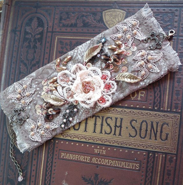 Capuccino Lace Cuff by Magical Mystery Tuca, via Flickr - hand sewn, hand beaded, vintage lace, crystals, crochet flower, brass fligrees, beads
