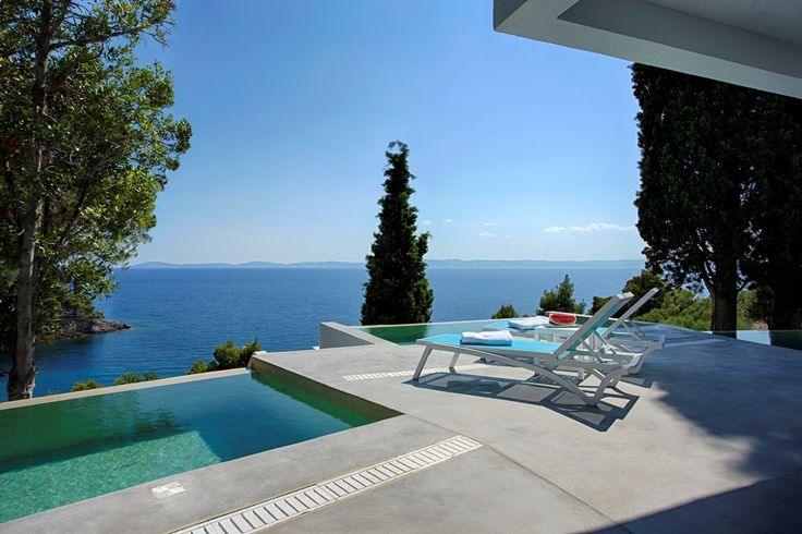 At Villa Kalyva Mare our guests are surrounded by pine trees and enjoy superb views of the crystal blue waters of Aegean Sea!  #BookNow: https://villakalyvamare.reserve-online.net/  #PortoCarras #VillaKalyvaMare #private #halkidiki #sithonia #poolside
