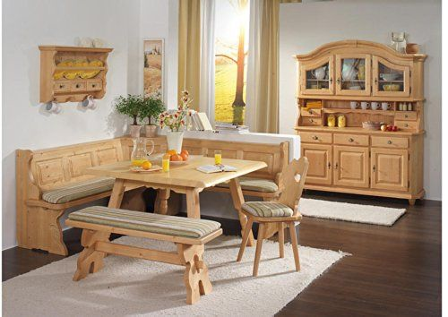 This is a solid filled Spruce wood corner dining furniture set with a large L-shaped dining bench, separate cushioned bench and cushioned matching chair.