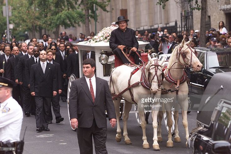 R&B singer Aaliyah's funeral procession arrives at St. Ignatius Loyola Roman Catholic Church in New York City. 8/31/2001. Photo: Evan Agostini/Getty Images.