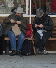 It's unusual to see a man knitting in public, but it's even more unusual to see two men knitting while having a gab. I couldn't quite see what they were up to, but both looked to be knitting socks.