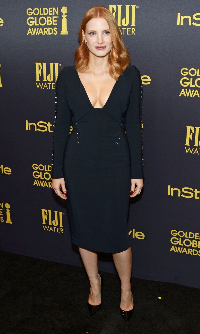 Jessica Chastain in a black plunging midi dress