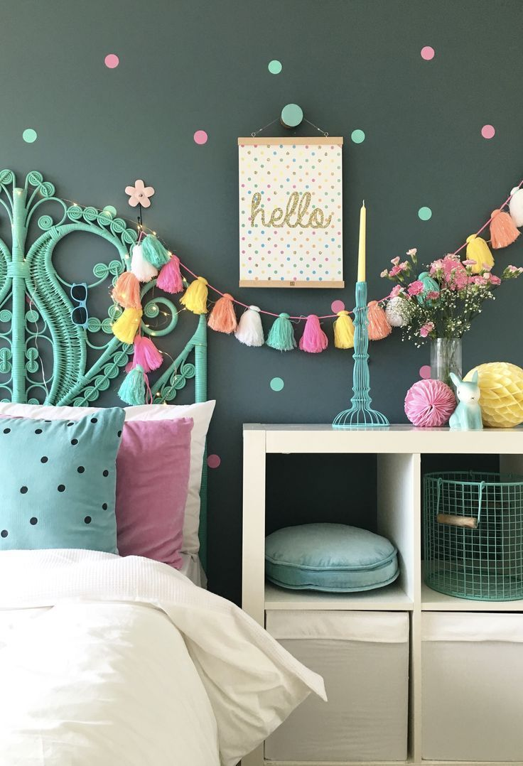 Colorful bedroom - featuring peacock bedhead and colourful tassle. More kids bedroom ideas and inspiration on the blog