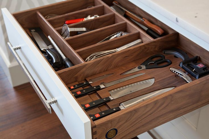 "Swanson used walnut as the finish for inside the drawers. ""I used wood floors in the kitchen, and I thought they matched nicely,"" she says. ..."