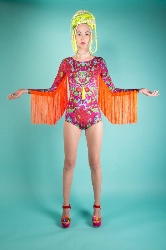 From the Folklorico Collection by Louise OMahony. This printed bodysuit, with neon fringe is made with very high quality luxury Lycra, that doesnt go see through when stretched always holds it shape (and helps hold yours!) Printed by one of the highest quality printers in the UK, the colours are bold and vivid and the fabric almost looks velvety.  It features a low back, and fringe that looks amazing when you move it around, you wont be able to keep still in it! You can wear it by itself…