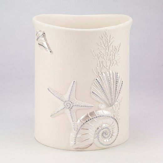 Give your bathroom a beachy feel Sequin Shells Wastebasket from Avanti. This stunning wastebasket stows away your trash in style. It comes in a rich, creamy off-white color with sequined seashell and starfish motifs adorning the front, while the textured finish on the outside contrasts beautifully with the silky smooth interior. You can pair this seashell trash can with other beach-themed accessories for a cohesive look.