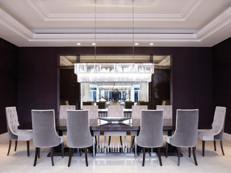 deep damson walls and pale glove grey velvet dining chairs | long rectangular chandelier || Louise Bradley