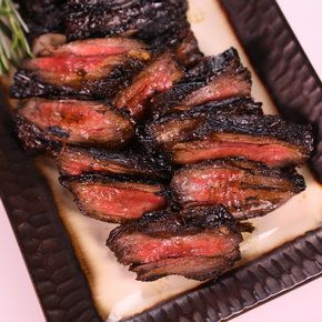 Michael Symon's Grilled Skirt Steak~ 1 1/2-2 pound Skirt Steak ( or Flank; Hanger; Beef Heart), 1 cup Balsamic Vinegar, 1/3 cup Brown Sugar, 2 Garlic cloves (smashed), 2 sprigs of Rosemary, 1 teaspoons Chili Flake, Olive Oil, Salt and Pepper