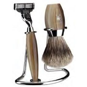 Exquisite shaving set with super badger shaving brush, double wire stand & razor.This three piece, hand made set comprises a beautifully balanced, light weight razor fitted with Gillette Mach 3 blade system, a matching hand filled badger shaving brush together with a smart double wire stand.  www.mantality.co.za
