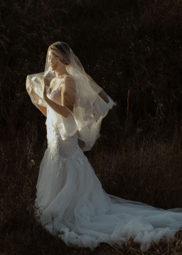 Bride with dramatic veil at golden hour; PHOTOGRAPHY by Joel + Justyna Bedford;