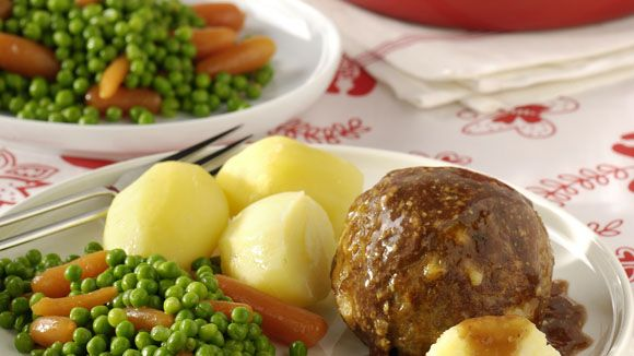 A traditional and kinda old fashioned Dutch meal consisting of boiled potatoes, boiled vegetables a meatball (gehaktbal) and gravy.