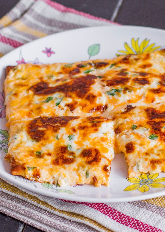 Cheesy Flat Breads – it's cheesy, it's gooey, it's delicious, it's your next snack.