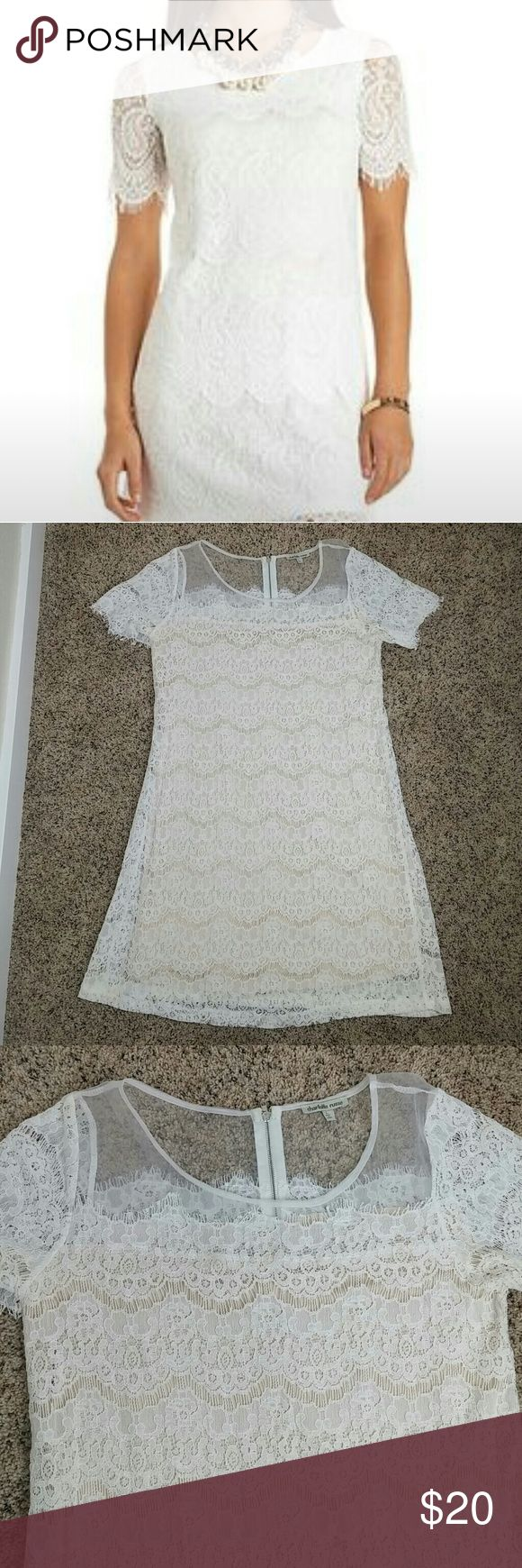 NWOT dress lace white nude New with out tags. White with nude slipper under. Super cute sleeves. Lace with see thru white mesh on top. Charlotte Russe Dresses Mini