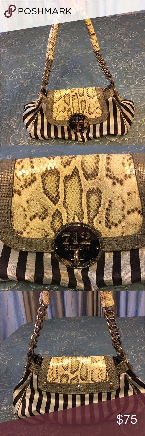 Henri Bendel snake skin and stripes purse Henri Bendel snake skin and brown/white signature stripe purse with chain link strap. Very cute purse. Only worn once. Inside is perfectly clean and a deep purple color. henri bendel Bags Shoulder Bags