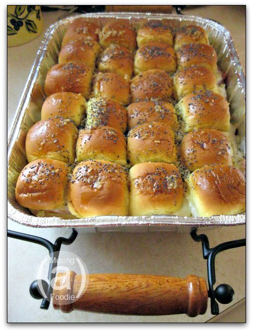 Hot Ham and Cheese Sandwiches- 2 24-packs King's Hawaiian Rolls (Party Potato Rolls are an okay substitute)  1 pound shaved Virginia ham  24 slices Swiss cheese  1-1/2 sticks butter  2 teaspoons Dijon mustard  2 teaspoons Worcestershire sauce  2 teaspoons dried onions  2 teaspoons poppy seeds